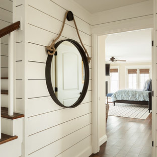 Inspiration for an expansive beach style hallway in Portland Maine with white walls and medium hardwood floors.