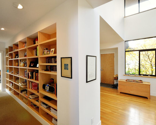 Example Of A Large Minimalist Medium Tone Wood Floor And Yellow Floor Hallway  Design In Seattle