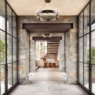 Ispirazione per un ingresso o corridoio design con pavimento grigio
