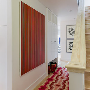 Inspiration for a mid-sized scandinavian light wood floor hallway remodel in Boston with white walls