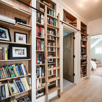 Inspiration for a transitional light wood floor and beige floor hallway remodel in Providence with white walls