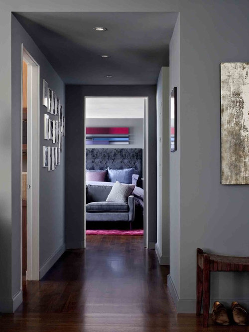 Example Of A Trendy Dark Wood Floor Hallway Design In New York With Gray Walls