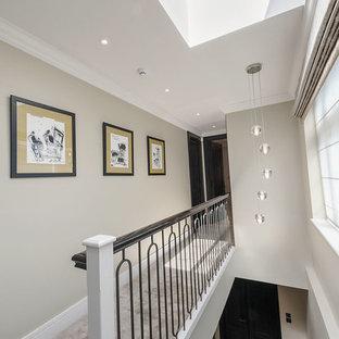 На фото: коридор среднего размера в современном стиле с бежевыми стенами, полом из керамической плитки, белым полом, кессонным потолком и обоями на стенах с