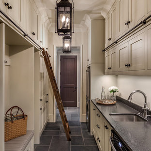 Inspiration for a mid-sized mediterranean slate floor and gray floor hallway remodel in Other with beige walls