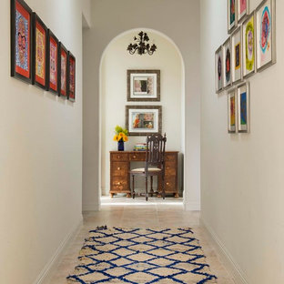 Hallway - mid-sized traditional ceramic floor hallway idea in San Diego with white walls
