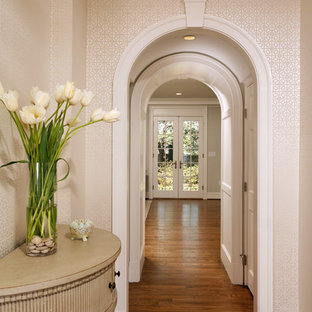 Inspiration for a timeless medium tone wood floor and brown floor hallway remodel in DC Metro with white walls