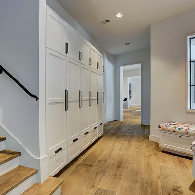 Inspiration for a transitional medium tone wood floor and brown floor hallway remodel in Houston with white walls