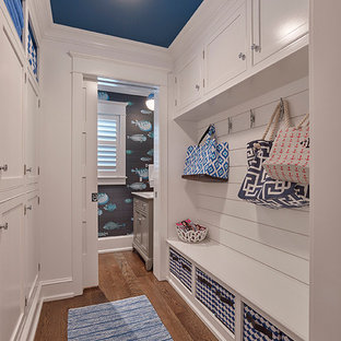 Design ideas for a beach style hallway in Philadelphia with white walls and medium hardwood floors.