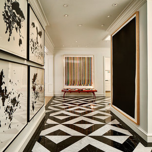 Inspiration for a large transitional marble floor hallway remodel in Dallas with white walls