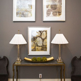 Photo of a mid-sized transitional hallway in New York with grey walls and dark hardwood floors.
