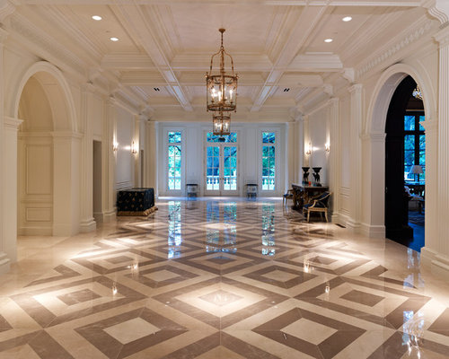 Dining room lighting ideas - Example Of An Expansive Classic Hallway Design In Dallas With White