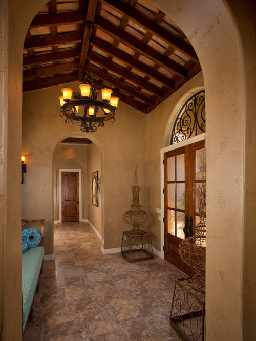 Example Of A Tuscan Hallway Design In Austin With Beige Walls