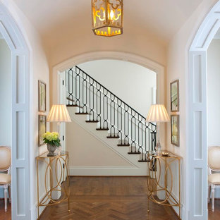 Inspiration for a timeless medium tone wood floor and brown floor hallway remodel in Dallas with white walls