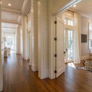 Photo of a beach style hallway in Miami with white walls and dark hardwood floors.