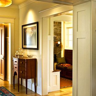 Inspiration for a mid-sized timeless medium tone wood floor and brown floor hallway remodel in Toronto with beige walls