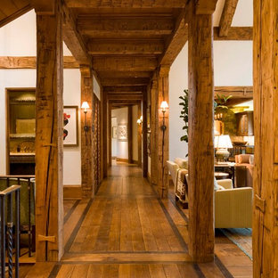 Inspiration for a huge rustic dark wood floor hallway remodel in Denver with white walls