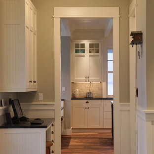 Inspiration for a traditional hallway in Seattle with grey walls and dark hardwood floors.