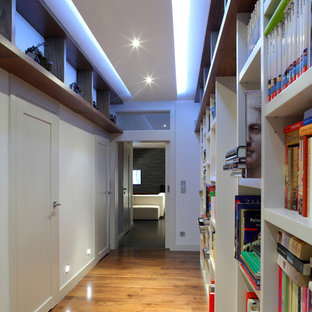 Inspiration for a contemporary medium tone wood floor hallway remodel in Other with white walls