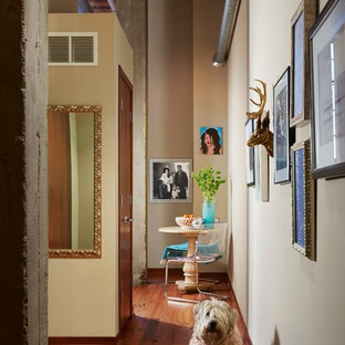 Hallway - industrial medium tone wood floor hallway idea in Minneapolis with beige walls