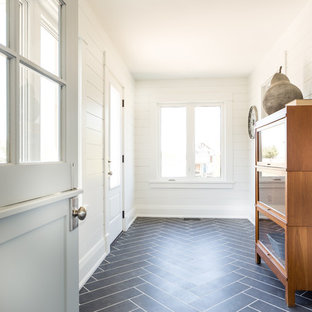 Inspiration for a large beach style hallway in Toronto with white walls, slate floors and grey floor.