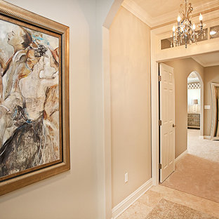 Mid-sized elegant ceramic tile and beige floor hallway photo in New York with beige walls