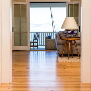 Inspiration for a mid-sized beach style hallway in Boston with beige walls, light hardwood floors and beige floor.