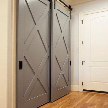 White Transitional Kitchen Featuring Custom Barn Door
