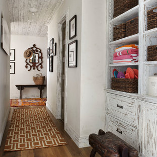 Inspiration for a country hallway in Milwaukee with white walls and dark hardwood floors.