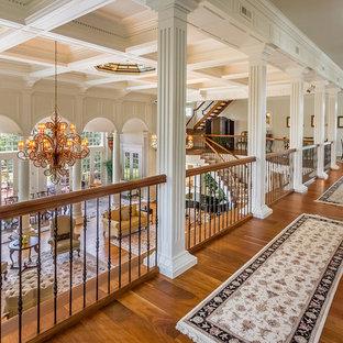 Example of a classic medium tone wood floor hallway design in Philadelphia with beige walls