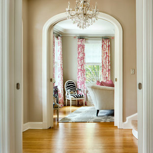 Hallway - transitional medium tone wood floor and yellow floor hallway idea in Austin with beige walls