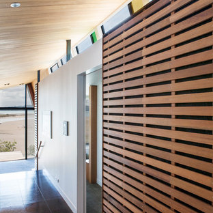 Trendy cork floor hallway photo in Auckland