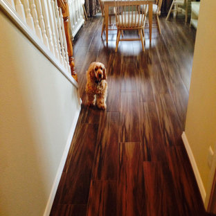Inspiration for a craftsman medium tone wood floor hallway remodel in Portland