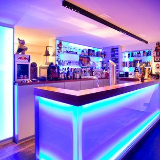 Design ideas for a contemporary home bar in Cologne.