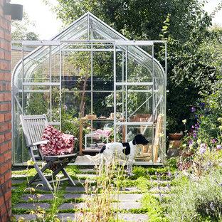 Photo of a farmhouse partial sun backyard formal garden in Aarhus.