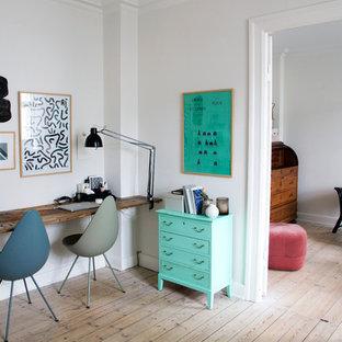 Study room - mid-sized scandinavian built-in desk light wood floor study room idea in Copenhagen with white walls and no fireplace