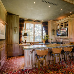 Wet bar - huge traditional l-shaped terra-cotta floor wet bar idea in Miami with an undermount sink, furniture-like cabinets, medium tone wood cabinets and granite countertops