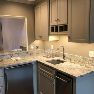 Inspiration for a small transitional l-shaped light wood floor and gray floor wet bar remodel in Other with an undermount sink, shaker cabinets, gray cabinets, granite countertops and gray backsplash