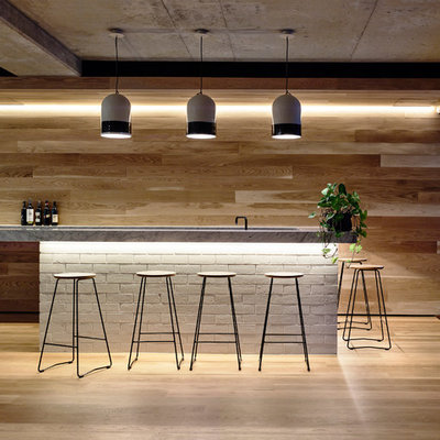 Large trendy seated home bar photo in Melbourne with marble countertops