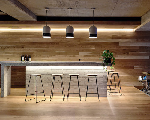 Photo Of A Large Contemporary U Shaped Seated Home Bar In Melbourne With  Marble Benchtops