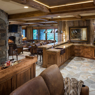Inspiration for a huge rustic u-shaped gray floor wet bar remodel in Salt Lake City with a drop-in sink, recessed-panel cabinets, medium tone wood cabinets, brown backsplash, wood backsplash and brown countertops