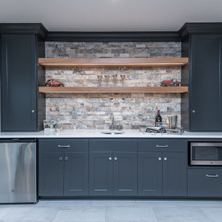 Design ideas for a transitional single-wall wet bar in Other with an undermount sink, shaker cabinets, grey cabinets, multi-coloured splashback, grey floor and white benchtop.