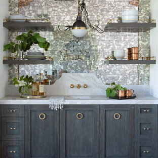 Inspiration for a medium sized country single-wall wet bar in Phoenix with a submerged sink, shaker cabinets, grey cabinets, marble worktops, multi-coloured splashback, mirror splashback, light hardwood flooring and white worktops.