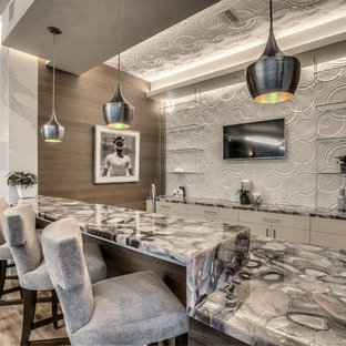 Example of a trendy galley dark wood floor and brown floor home bar design in Miami with flat-panel cabinets, white cabinets, white backsplash and gray countertops