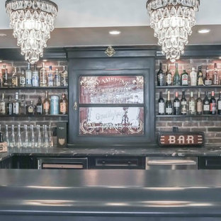 This is an example of a medium sized u-shaped wet bar in Calgary with shaker cabinets, black cabinets, marble worktops, red splashback, brick splashback, ceramic flooring and multi-coloured floors.