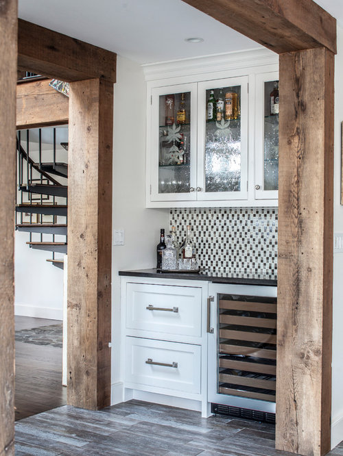 Inspiration For A Farmhouse Porcelain Floor Wet Bar Remodel In New York With Recessed Panel