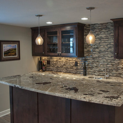 Large trendy galley wet bar photo in Minneapolis with an undermount sink, flat-panel cabinets, dark wood cabinets, granite countertops, brown backsplash and glass tile backsplash