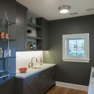 Huge cottage light wood floor wet bar photo in Grand Rapids with an integrated sink, shaker cabinets, gray cabinets, white backsplash and white countertops