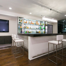 Contemporary Home Bar by Joseph and Curtis Custom Wine Cellars