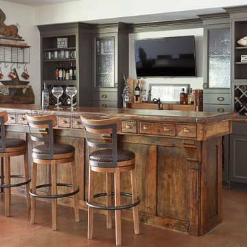 Antique Bar with Apothecary Drawers and Gray Perimeter Cabinets