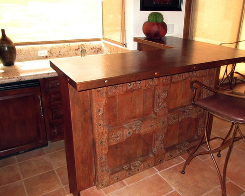 Hammered copper countertop and carved mahogany southwest for Bar style countertop